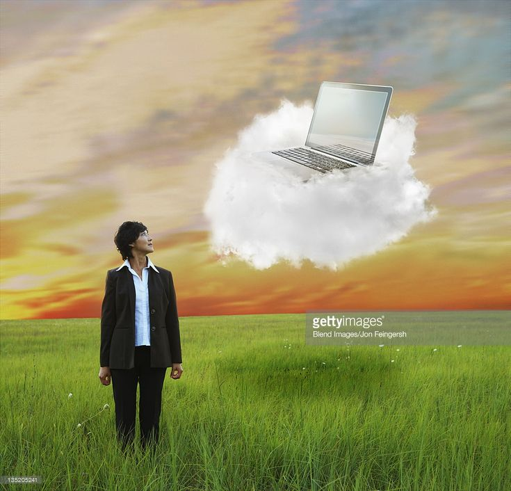 Stock Photo : Kazakhstan businesswoman looking at laptop on cloud
