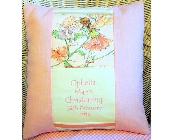 Birth/Christening cushion featuring a traditional Flower Fairy.