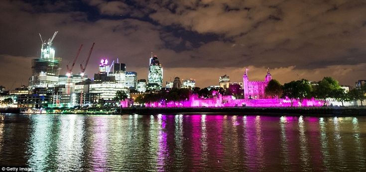 A good cause: The Tower of London's light even lit the clouds with a pink hue. Tower 42 can be seen on the horizon to the left.  In honour of Breast Cancer Awareness 3rd Oct 2012