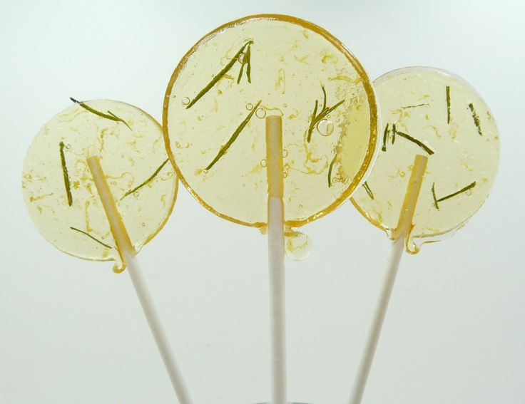 Our favors- Grapefruit Rosemary and Orange Thyme Lollipops. There are so many to choose from! (TheGroovyBaker on Etsy)