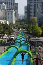 """""""Slide The City!"""" A fundraiser for charity lets people enjoy a massive water slide -- right down the center of a city street!"""