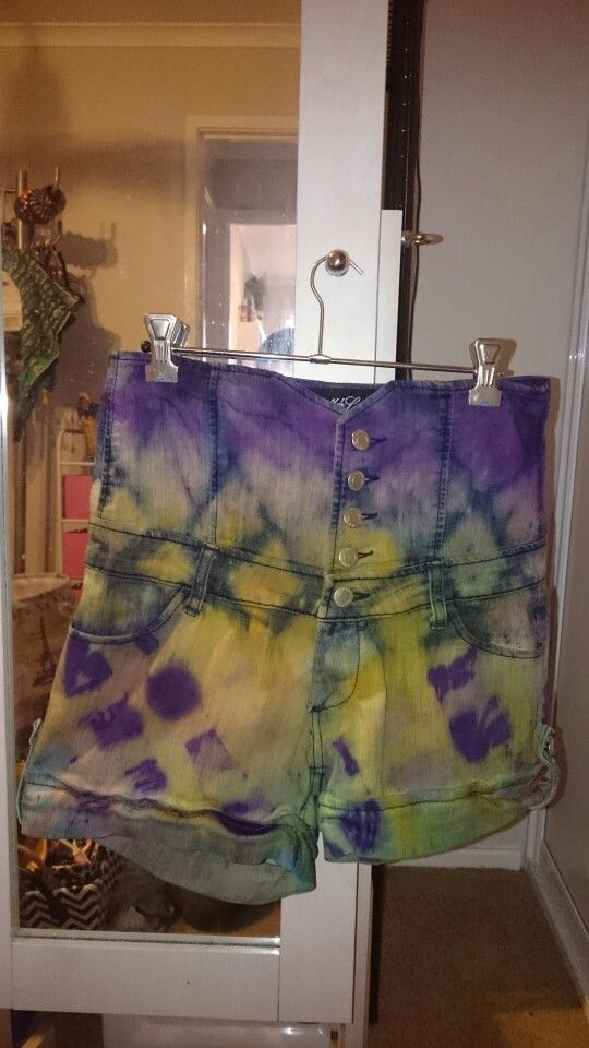 Dyed and bleached in layers; using duct tape and sponge