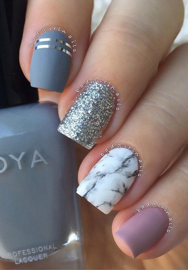 As we can see all nails are different but it isn't conspicuously. Colors and designs are very nice are combined so that they look very attractive.Marble nails are very neat and trendy.