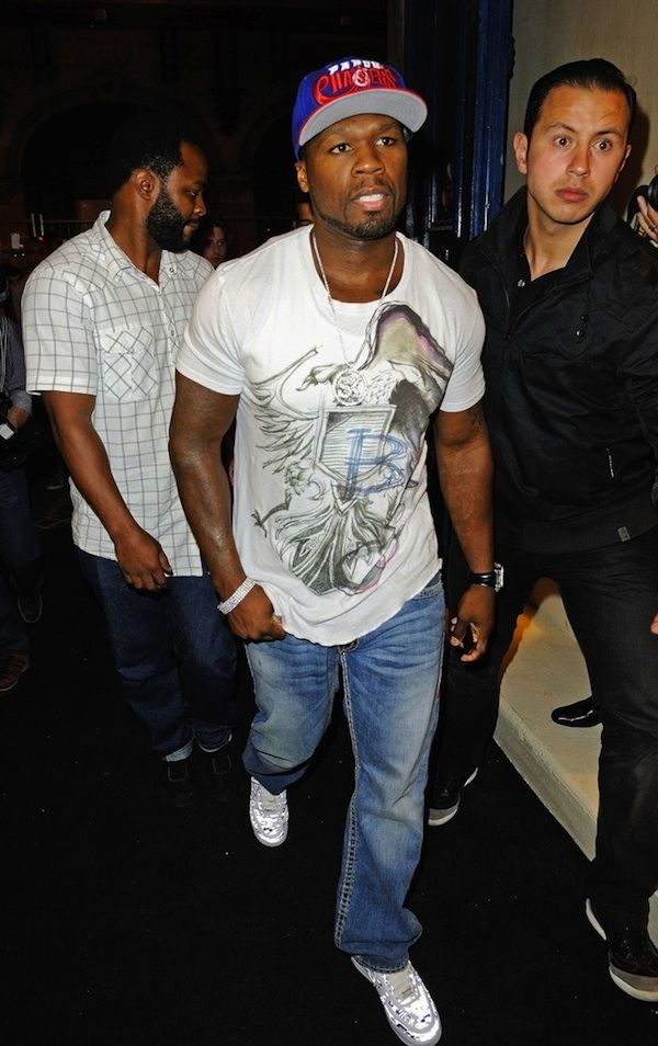 Rapper 50 Cent celebrated his birthday amongst his fans at Le Vendome in Paris, France. He kept his look simple wearing a Paper Chasers fitted cap, a colored eagle printed t-shirt from the Balmain Fall/Winter 2012 Collection, denim jeans, and sneakers.