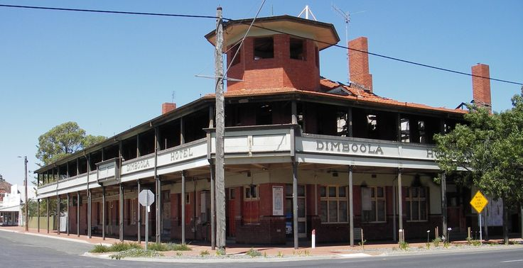 The shell of the burnt-out Dimboola Hotel. The blaze was on 26 October 2003. Cause of the fire is still unknown but is believed to have originated in the office area on the ground floor of the hotel, on the Lloyd Street side of the building. The fire caused an estimated $2 million worth of damage destroying both floors of the hotel & the adjoining Dimboola Cafe under the common roof. The building was finally demolished in August 2014. Built in 1930 it replaced the original weatherboard…