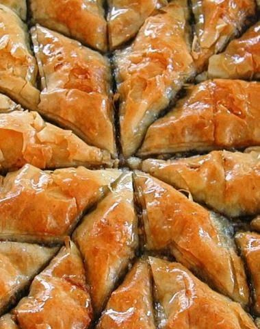 Baklava Recipe - Perhaps you are one of many that recognizes this fabulous pastry by its layers of nuts and many sheets of filo, of which you will need twenty to forty of them to make this type of pastry. This unique dessert is usually bathed in syrup, flavored with rose and brandy.