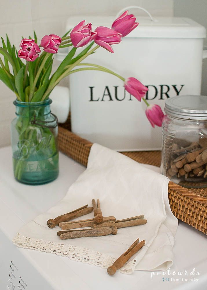 Find out how to transform a small laundry room on a tight budget. You'll love the transformation of this tiny room into a refreshing little oasis.
