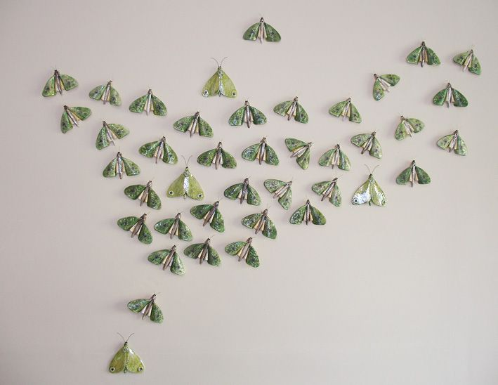 Moon Flight. Puriri Moth installation. Mid fired Porcelain. 2014. The Puriri Moth spends several years as a grub in the Puriri Tree, only to live for two days as a moth. By Kirsty Gardiner