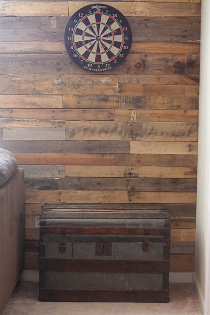 Very cool, honeysuckleblog! ~   pallet accent wall for dart board
