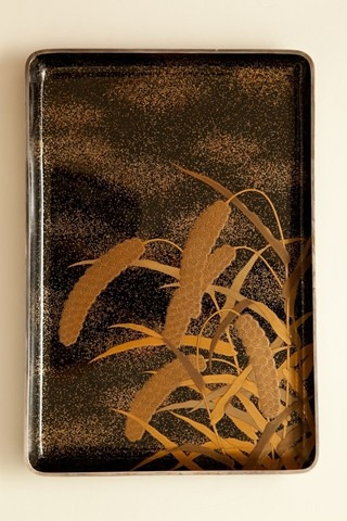Japanese lacquer tray with gold millet design on nashiji sprinkled black lacquer and silver rim.