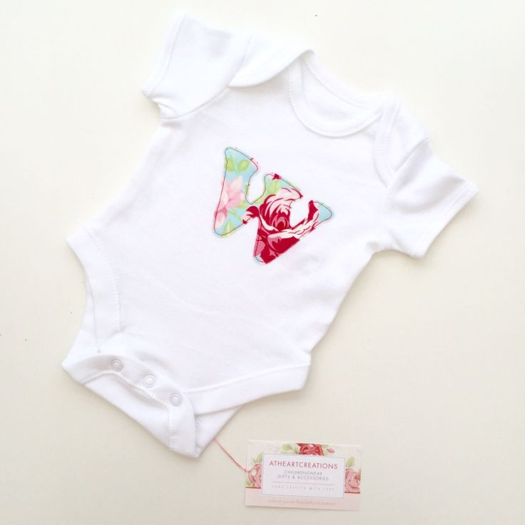 Lots of beautiful prints to choose from for my appliqué initial baby grows!