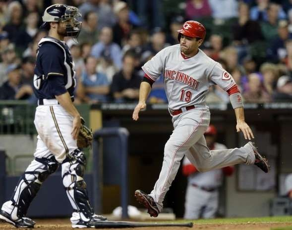 Cincinnati Reds' Joey Votto (19) scores past Milwaukee Brewers catcher Jonathan Lucroy during the ninth inning of a baseball game, Wednesday.: Cincinnati Red, App