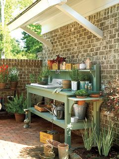 A potting bench with an outdoor sink keeps gardening projects organized in this Senoia, Georgia courtyard.