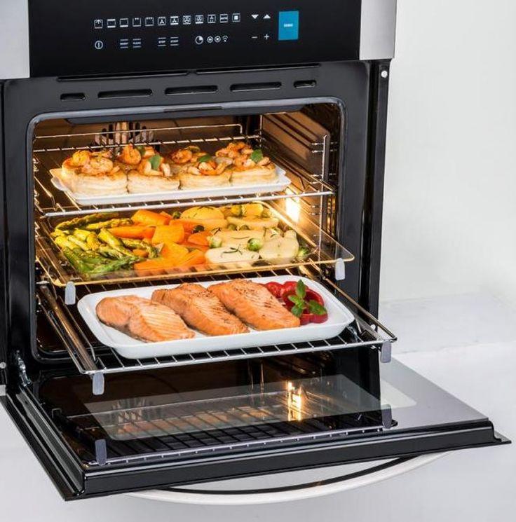 Forno TOWER TO58EB  Prepara simultaneamente diferentes pratos no forno sem misturar os odores e sabores dos alimentos. Oferece uma redução de 25% do tempo de preparo e permite utilizar toda a capacidade do forno. #TECNO #FORNO