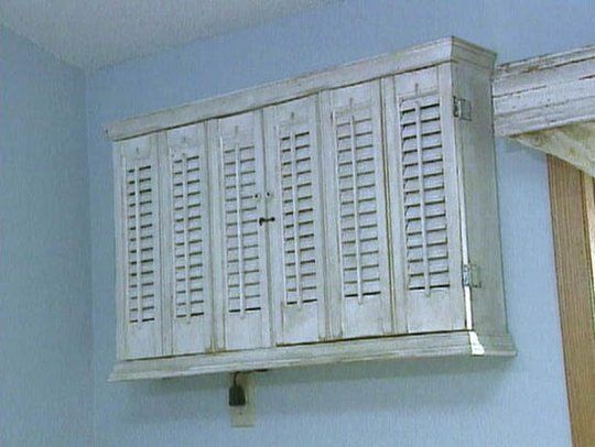 """Hide a swamp cooler with a """"shelving unit"""". I'd probably include the outlet inside as well."""
