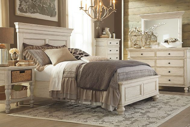 distressed vintage look on this queen panel bed and bedroom furniture set