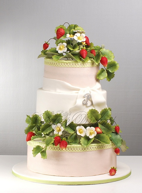A cake that is very spring-y, with strawberries. This is a wedding cake, but this would be lovelier for a shower, I think.