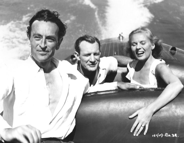 Trevor Howard, Ann Todd and director David Lean on the water while filming The Passionate Friends, 1949