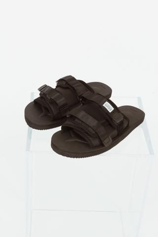 5843bbaa047e ... in black by Suicoke. Slip-on sandals with open round toe. Dual  adjustable nylon webbing velcro straps. Tonal rubber footbed and treaded  Vibram® sole.