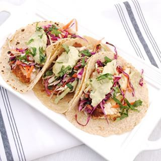 Halibut Fish Tacos with Citrus Cabbage Slaw and Avocado Crema. One of the best fish taco recipes around! @nourishrds