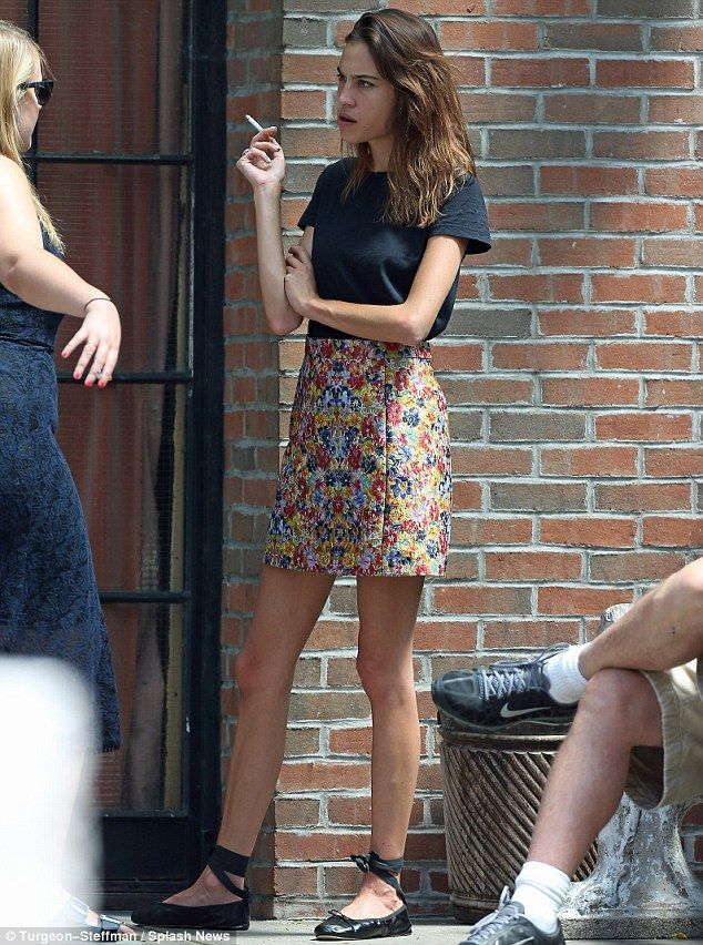 Taking five: Alexa Chung displays her VERY thin frame as she puffs on a cigarette with a p...