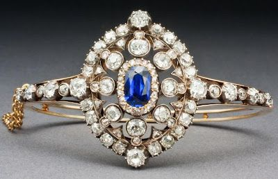 Victorian Hunt & Roskell sapphire and diamond bracelet, circa 1880. The openwork center is set with an oval-cut royal blue Burmese sapphire within a larger cluster of old European-cut and rose-cut diamonds. The bracelet has a pin attachment and can convert into a brooch. Via Diamonds in the Library.