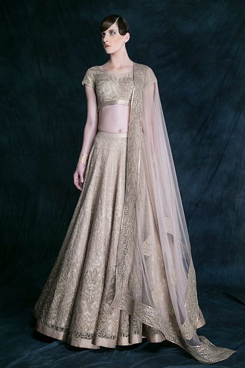 Sartorial style defined in elegance compliments an intricately embellished layered Lehenga The silhouette which truly represents the glamorous yet feminine bride who glories in her curves and inherent refined style on her D-day #ShantanuNikhil #SpringSummer15 #Top5BridalTrends
