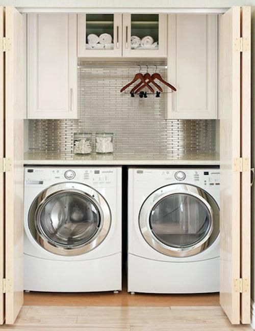 small space laundry room. I Like the cabinets to hide things and the shelf on top of the machines.... could use some color though! @Ashlee Outsen Bryant
