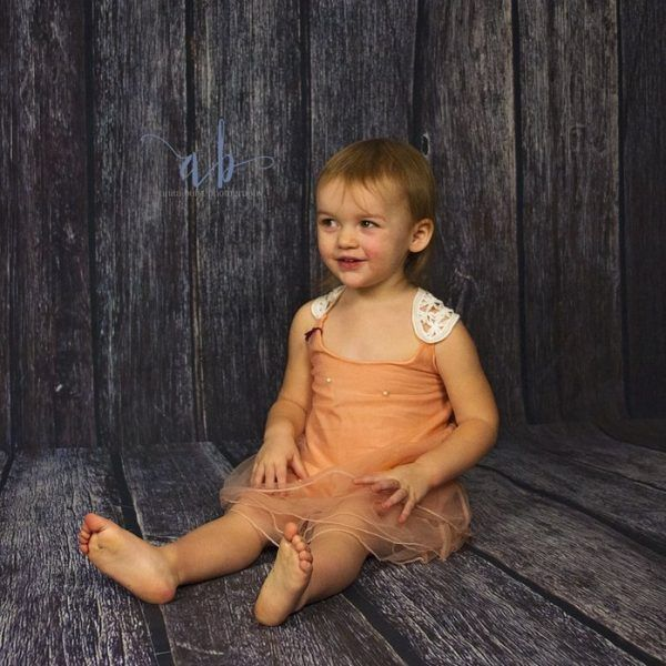beautiful peach dress with crocheted details and pearls