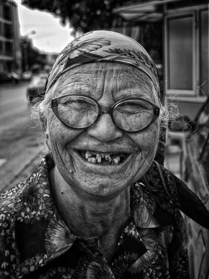 Beautiful, oldie, old, aged, glasses, missing teeth, face, wrinckles, smile, beauty, portrait, photograph, photo b/w.