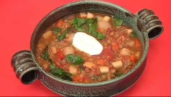 Vegetarian lentil soup with root vegetables and swiss chard