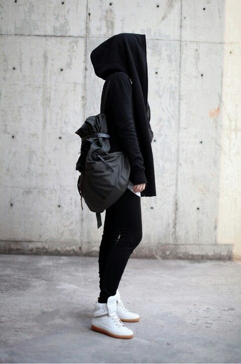 Black coat, black pants, black backpack, white shoes