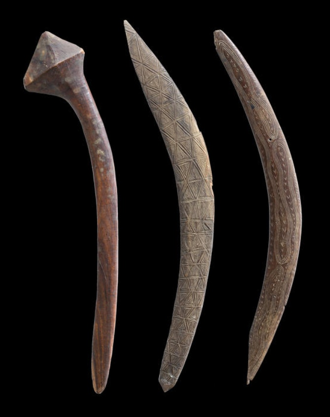 Two Boomerangs and a Club, New South Wales and South West Queensland   carved and engraved hardwood; carved hardwood  Lengths: 62cm, 64cm, 64cm respectively