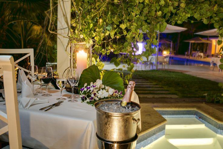 Romantic dinner setting at Bamboo Restaurant, Tortuga Bay Hotel