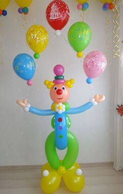 A juggling clown... he seems to keep all his balloons in the air!