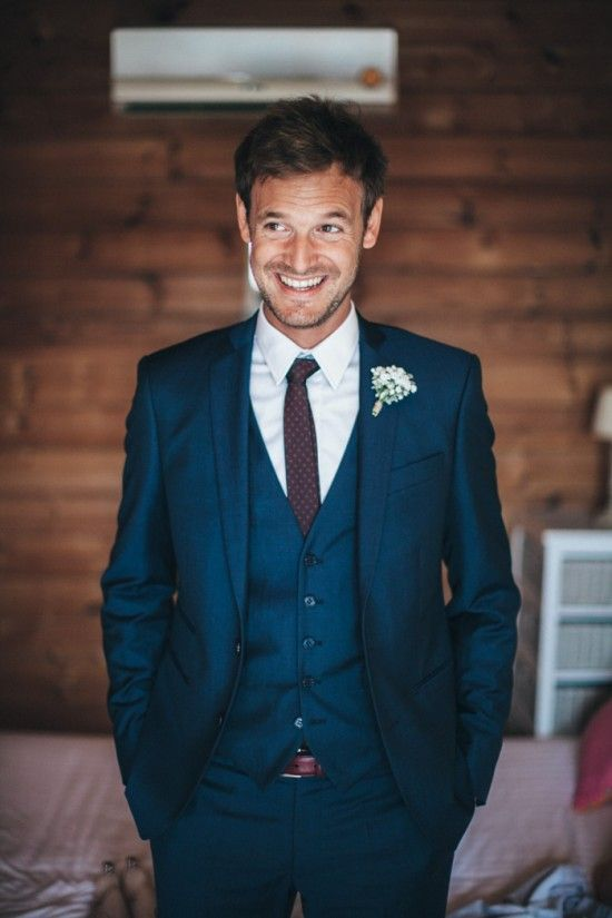 Navy Suit. But with a light blue tie for Mason. And for the groomsman a tie to match the girls dresses. - Kim