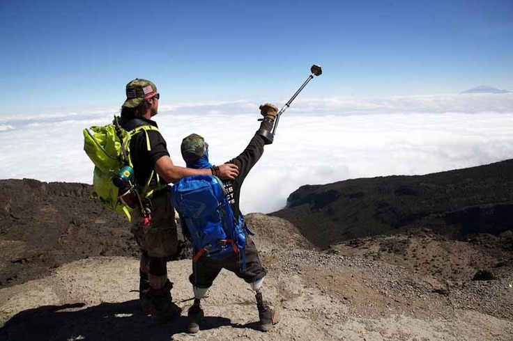 Staff Sgt. Mark Zambon, right, celebrates atop Mt. Kilimanjaro, Africa's tallest mountain, in July with Tim Medvetz, leader of The Hero's Project. Medvetz works with wounded troops to climb mountains on all seven continents, helping them overcome the emotional stress of their injuries.
