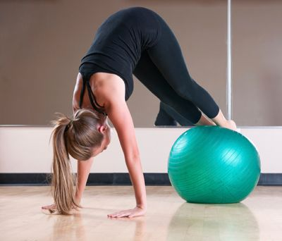 Challenge your balance and core muscles with these 25 Swiss ball exercises that work your entire body.