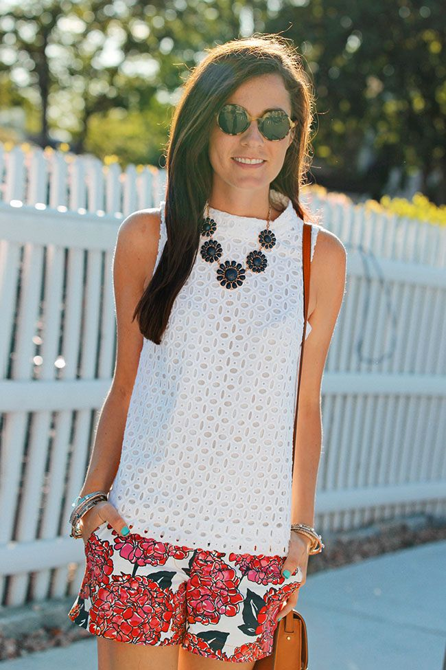 White eyelet lace J. Crew Shirt, Vineyard Vines pink hydrangea shorts, and Kate Spade navy and gold necklace