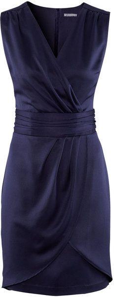 vestido azul cruzado desde arriba hasta abajo, con mini pices y con fajin en la cintura