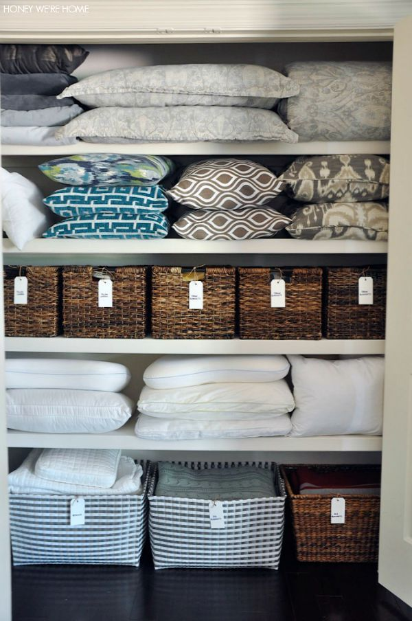 Organized Linen Closet With Woven Bins From Goal And Handwritten Labels | Hone…