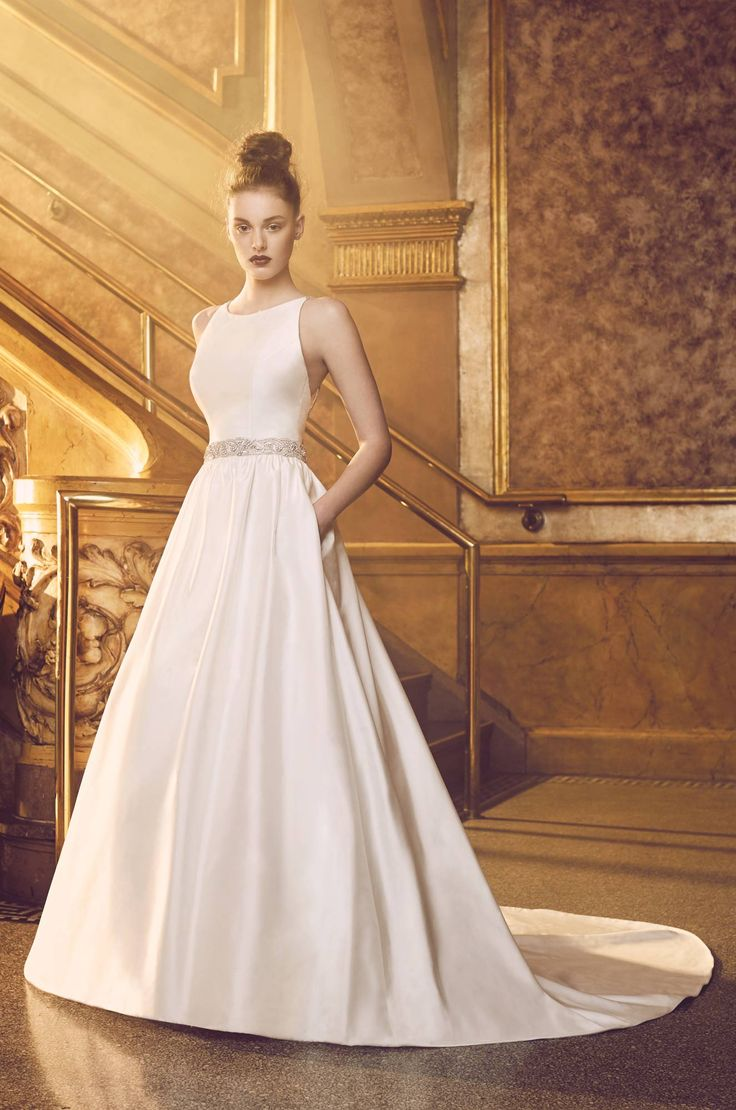 View our Full Silk Wedding Dress - Style #4719 from Paloma Blanca. Sleeveless bodice with bateau neckline, double beaded spaghetti straps, and full skirt.
