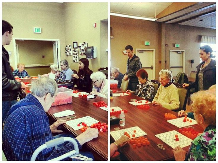 Albany American Marketing Association students playing Bingo with residents at the Atria Senior Living community.
