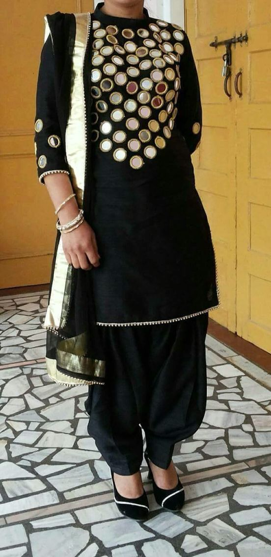 black salwar suit with mirror work on body.. get it at http://mytailor.in