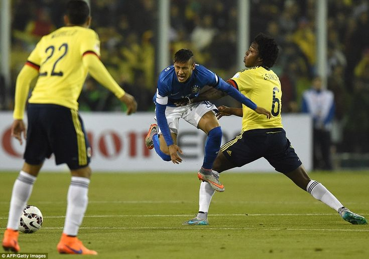 Neymar feels the force of Colombia's Carlos Sanchez during a frustrating night for the Bra...