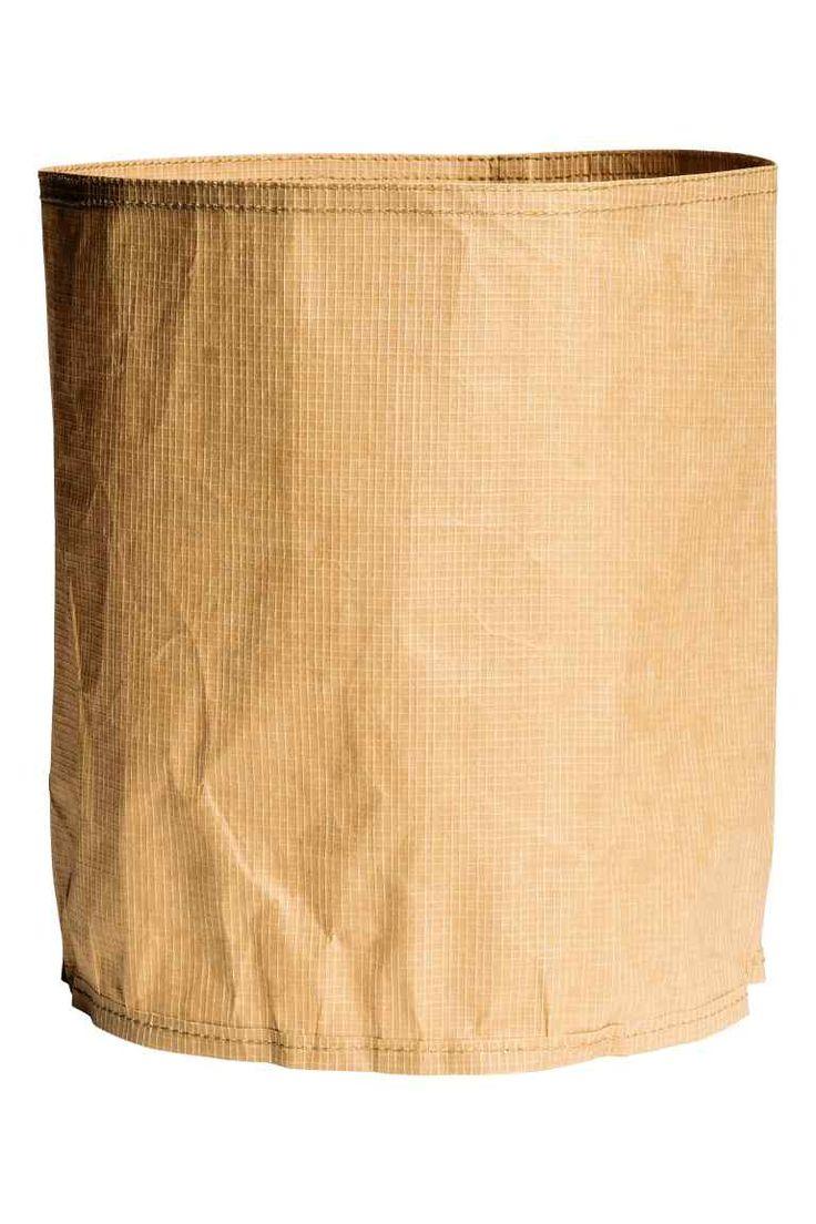 Kosz do przechowywania: Cylindryczny kosz do przechowywania ze wzmocnionego papieru. Średnica 22 cm, wysokość 25 cm.