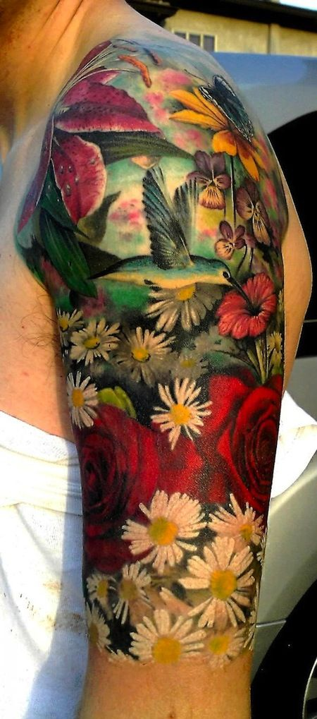 Colourful bird and flower tattoo