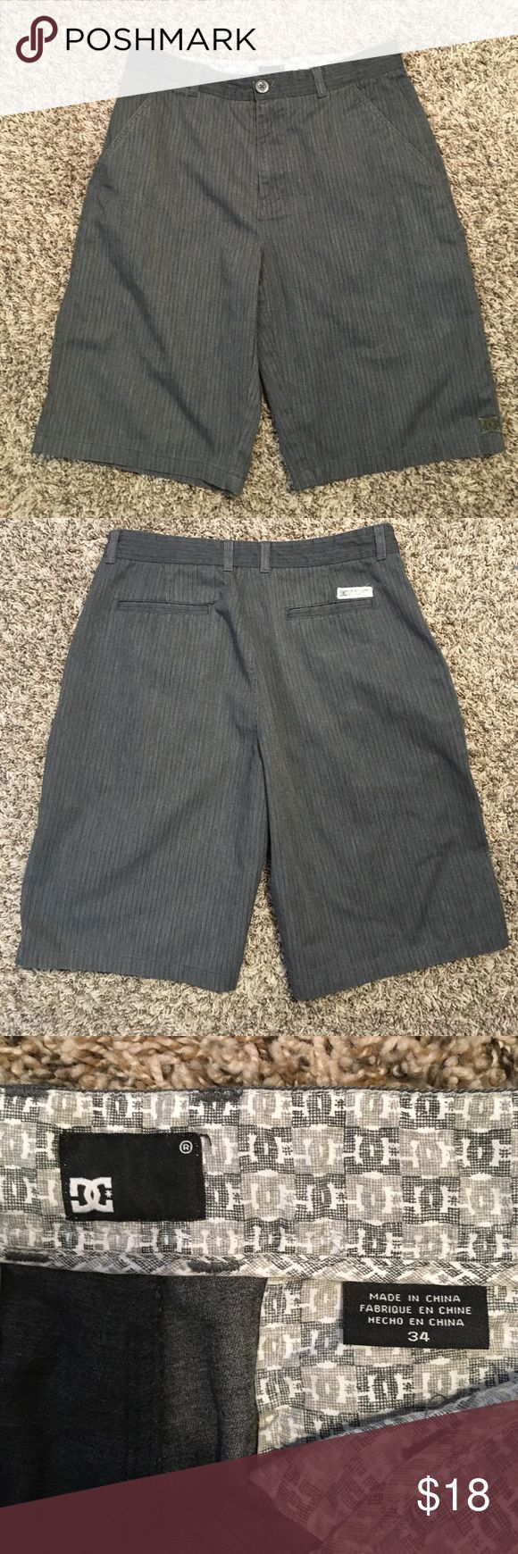 "DC Skate Shorts Men's size 34 DC Skate Shorts. Zipper Fly with Button Closure. Inseam measures 11"". Gray pinstriped.  Great preowned condition. Any questions please ask. Thank You 😊 DC Shorts Flat Front"