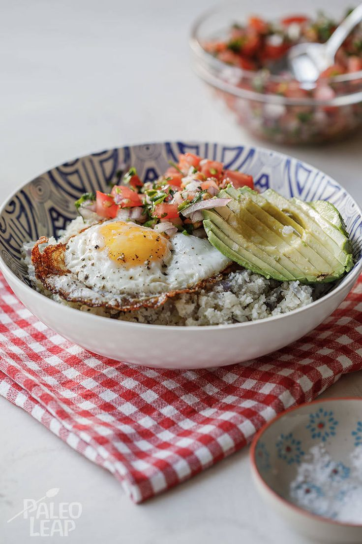 Save the granola bar for a snack and start your day off right with a Paleo breakfast bowl of epic proportions - egg, avocado and Pico de Gallo included.