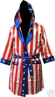 Hit the ring in style with this star-spangled American flag satin robe from the Rocky franchise, an awesome reproduction of the one worn by the original champ Apollo Creed. Features all over red, white, and blue design with hood, sash belt. Stay in school and use your brain. Take Apollo's advice, be a doctor, be a lawyer, carry a leather briefcase. And whatever you do, be sure to follow his example in satin too. Robe: one size fits most.